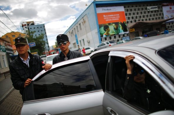 Members of the Mongolian neo-Nazi group Tsagaan Khass leave their headquarters in Ulan Bator